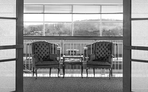 two armchairs located in the lobby of the stock and leader office