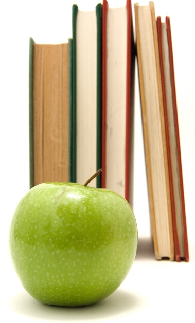 Image: books and a green apple