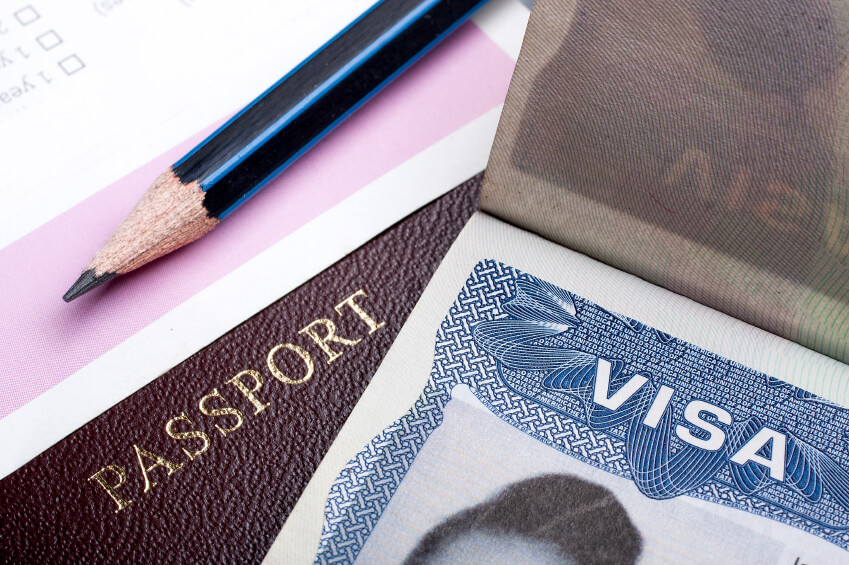 Image: Passport and US visa background with immigration application form.
