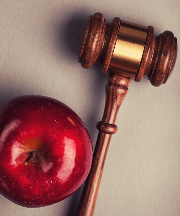 Image: a gavel and an apple