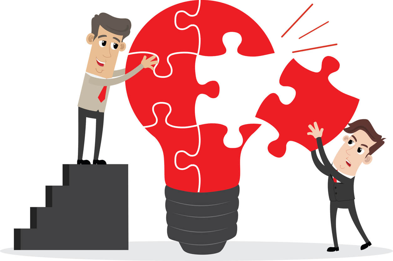 Image: Businessman completing an idea light bulb puzzle