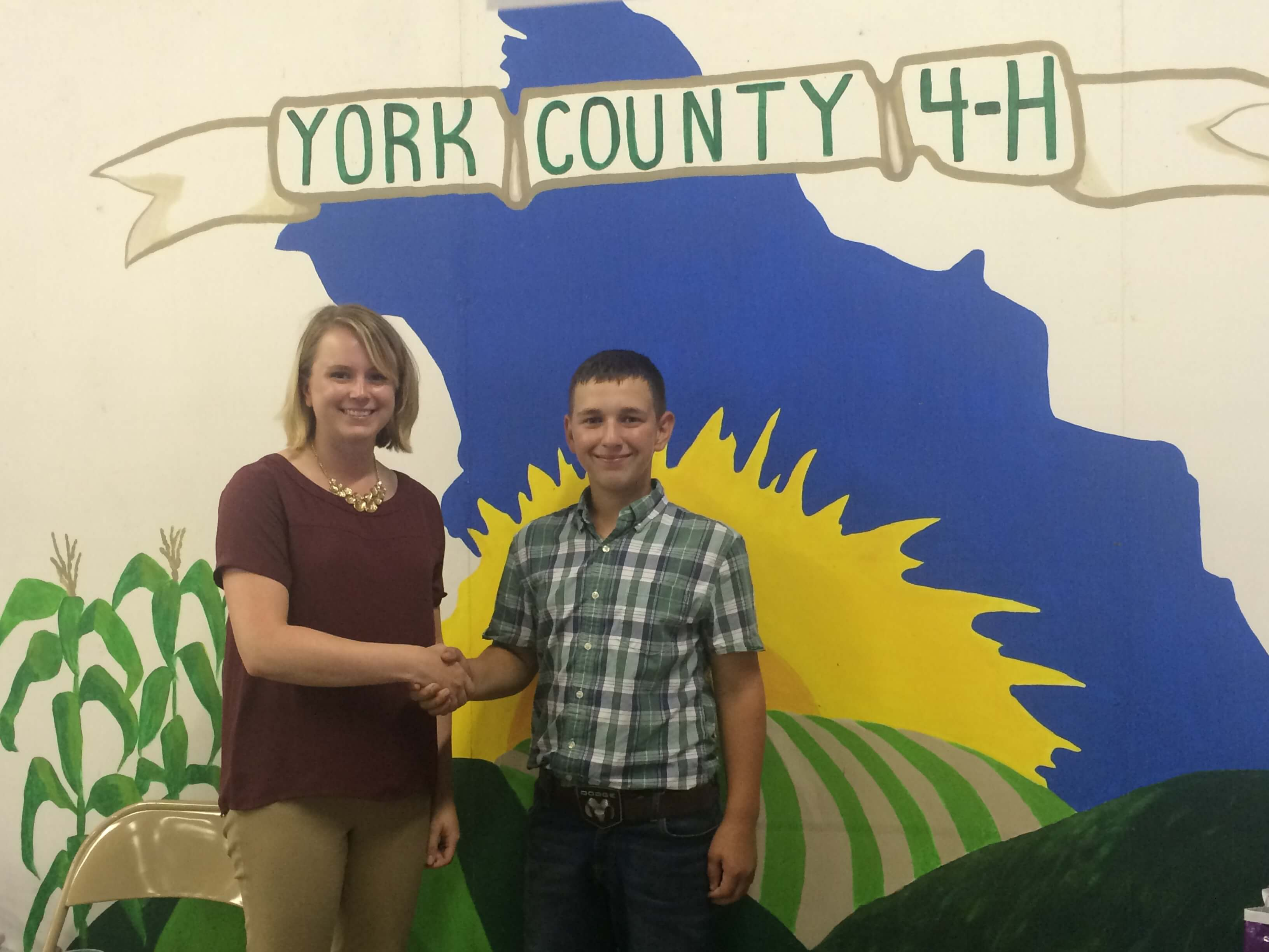Image: Attorney Hynes shaking hands with a 4-H student