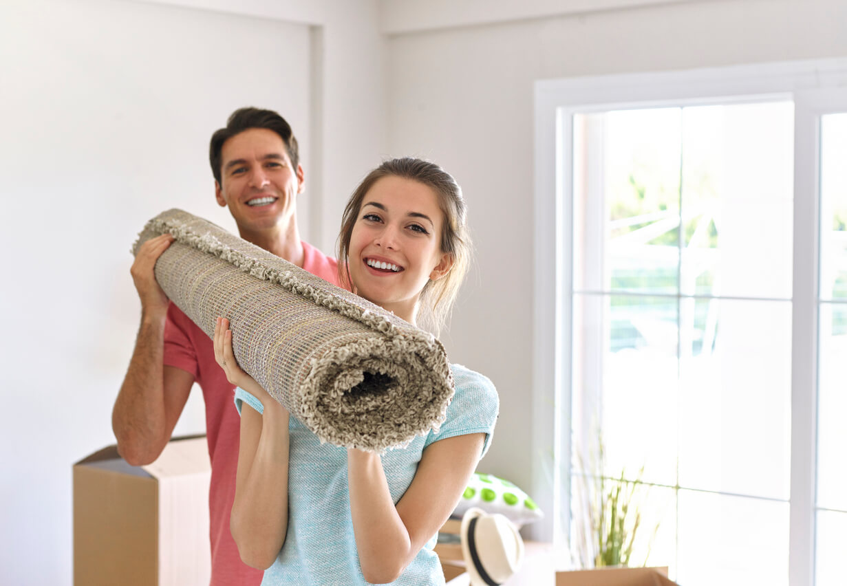 Image: Couple carrying carpet