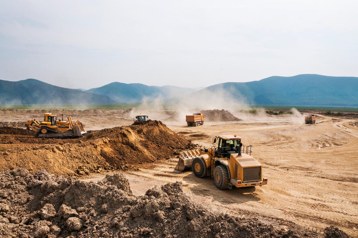 Image: construction trucks working