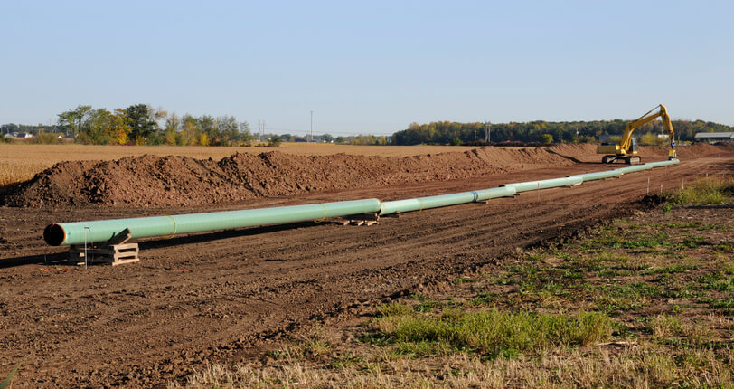 Image: a gas pipeline being installed in a field